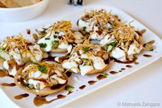 Papri Chaat - Indian street food made of thin wafers of fried dough, yogurt, chutneys, chickpeas and potatoes