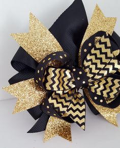 Gold Glitter Hair Bow- Babys first Birthday Bow- 4 inch Metallic Gold Pinwheel Bow on clip- Black and Gold Winter Girls Hair bow- #272 by ClamsAndaHamDog on Etsy www.etsy.com/...