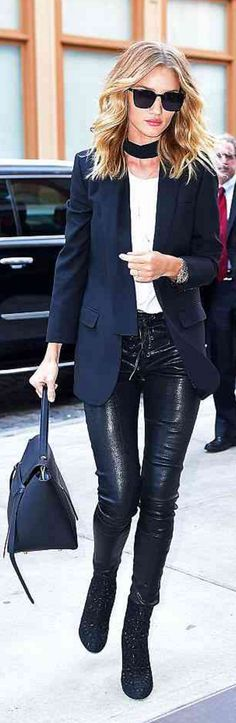 Who made Rosie Huntington-Whiteley's black sunglasses, blazer, leather skinny pants, gold jewelry, handbag, and suede ankle boots?