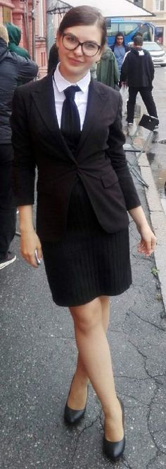 Dressed For Formal Occasion In Black Skirt Suit White Shirt And Black Tie