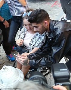 Man of the people: Zayn made plenty of time for fans who waited eagerly to meet their idol