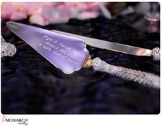To personalize your cake knives, have both you and your fiance's name, the date of your reception, as well as a small quote  engraved in a white font in script, that describes your loving relationship.