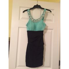 Short sexy dress Only worn once for about two hours. Super cute. Couldn't find a good picture on. Color is kind of a light teal. Stretchy and comfy with no zippers or buttons. Beautiful bejeweled halter top. Jodi Kristopher Dresses Mini