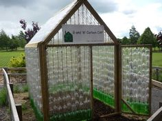 Green house out of 2 liter soda pop bottles.