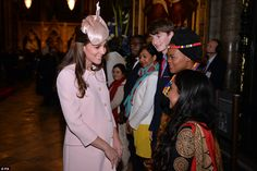 Warm words: The Duchess of Cambridge stopped to chat with some of the younger guests as sh...