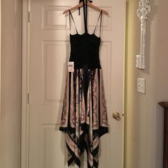 Dress with tie halter Black tie halter dress with scarf bottom. Great party dress. Never worn. Tags still on dress. Dresses