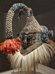 Africa | Mask (Mukenga) Kuba Western Kasai region Democratic Republic of the Congo Late 19th-20th century CE Wood glass beads cowrie shells feathers raffia fur fabric string and bells | Photographed at the Art Institute of Chicago, Chicago, Illinois.