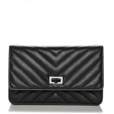 This is an authentic CHANEL Sheepskin Chevron Quilted Reissue Wallet On Chain WOC in So Black. This stylish cross body wallet is crafted of chevron quilted aged calfskin leather in black.