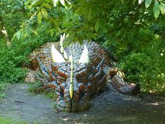 Druidstone Park, Blean  Dragon sculpture by the footpath in the Enchanted Wood.  Great Britain.