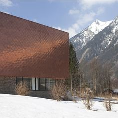 Scales of copper cover fire station in French Alps by Studio Gardoni Architectures