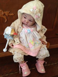 Adorable! ~ I love to give my dolls real baby clothes.