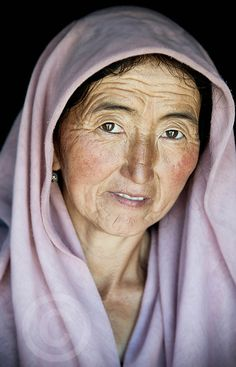 Tajikistan woman shows us lines of time and yet she has wonder in her eyes.