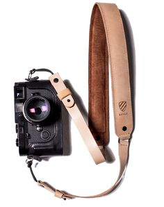Made with nylon webbing and 550 Paracord, originally used in the suspension lines of US parachutes during World War II, it's a sturdy strap that will keep your camera secure and looking good. Preorder now at langly.co