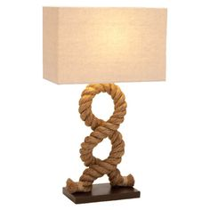 Metal and wood table lamp in cream and natural with a twisted rope base.     Product: Table lamp  Construction Mater...