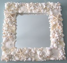 Beach decor seashell mirror. My nautical decor shell mirror is artisan crafted in gorgeous all white, fully covered in white shells, starfish, sand dollars, and tiny pearls. Its a gorgeous shell mirror for beach decor or nautical decor, each one unique and artisan handmade.  Carefully created meticulously by hand, this amazing mirror includes a variety of Indian Ocean white seashells, brilliant white Florida sand dollars, bleached natural starfish, and delicate pearl accents. Each is hand…