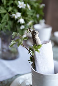 Hand carved rabbit clothespin as table accessory. love.