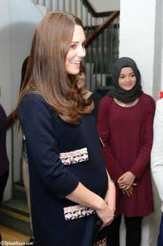 Finally, a great bump picture!  Kate in Madderson London for an Art Room opening