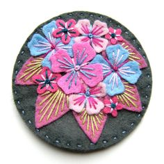 Hydrangea felt brooch with freeform embroidery by designedbyjane... i love these embroidered felt flowers!!