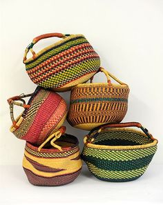 Hand woven from elephant grass with leather wrapped handle x x cm African Interior Design, Interior Design Elements, Travel Bag Essentials, Travel Bags, Women's Suitcases, Rattan, African Home Decor, Round Basket, Everyday Items