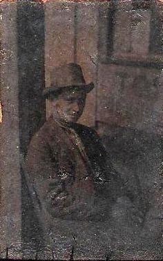 Tin type of a man in front of a store