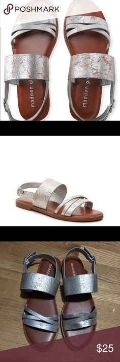 NWT Madden Girl Strappy Sandals Never worn, comes new in box. Faux leather sandals with brushed silver straps. Can be worn casual but also fancy enough for a wedding or party. Add a little shine to your outfit. Straps are super stretchy, not tight. Feel free to ask any questions. All REASONABLE offers will be accepted. Check me out on 〽️ercari for the best price. If you don't see the item just ask and I'll add it. Madden Girl Shoes Sandals