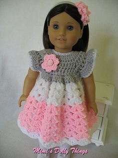Crocheted doll clothes for 18 inch dolls including American girl. Dress Pink, grey and white with head band. $20.00, via Etsy.