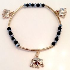 Three Elephant Black Bracelet Triple your luck with this adorable (3) elephant purple bracelet. The elephant is a symbol of good luck and warding off evil energy. Brand New. Unknown Jewelry Bracelets