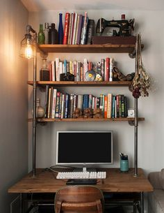 "This listing is for a reclaimed wooden computer desk with three storage shelves and industrial pipe legs and built-in lamp. Dimensions of the desk shown in the photos is 42"" wide x 24"" deep x 30"" tall. Shelves are 42"" wide and 10"" deep and are spaced 12"" apart. Total height of"