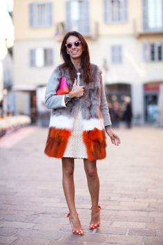 A major fur coat and whimsical slingbacks are everything. MFW street style
