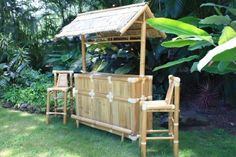 BAMBOO TIKI BAR - ISLAND TIKI BAR NATURAL W/ 3 BAR STOOLS - TROPICAL DECOR by Tikimaster. $1090.00. TIKI BAR: TROPICAL DECOR Imagine yourself sipping a Mai Tai, Strawberry Daiquiri or other cool tropical drink by the pool while seated at your own authentic Tiki bar! Hand constructed from high quality bamboo & hardwoods, these sets are sturdy as well as beautiful . Roof panels are hand-crafted thatch. Our Tiki bars include durable bar stools , a built -in rack f...