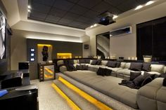 The good home theater design is a room that can be enjoyed comfortably while hanging out with family and friends. Here are some explanations about the Home Theater Room Design Ideas that can inspire you to design your Home Theatre room. Home Theater Room Design, Home Cinema Room, Home Theater Rooms, Home Theater Seating, Theater Seats, Attic Theater, Home Theater Basement, Theater Room Decor, Game Room Design