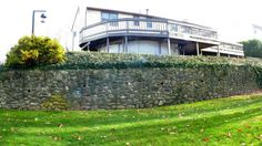 The retaining wall was built 30 years ago.  With proper drainage, this wall looks as good as new.
