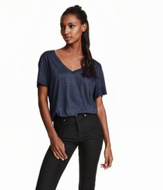 V-neck top in airy jersey with a slight sheen and a soft drape. Short sleeves.