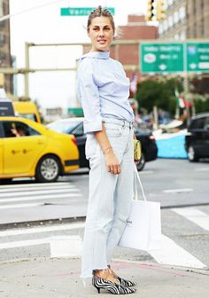 A button-down shirt is worn backwards with light wash jeans and faux zebra Céline heels