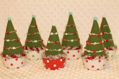 little wool christmas trees in dotty dishes