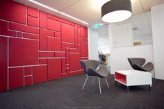 BECA Offices – Fabwall 50™ acoustic wall panels used in various shapes creating a mosaic wall effect