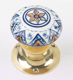 Pair of Ceramic Sprung Door Knobs inc. Spindle & Fixing Screws. White / Orange / Blue Design & Polished Brass: Amazon.co.uk: DIY & Tools