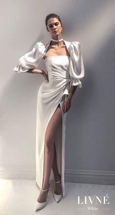 Unique Looks Perfect for the Modern Bride -- Livné White Wedding Dresses |Full story: Wedding Inspirasi // Half balloon sleeves straight across neckline simple minimalist high slit skirt elegant sheath wedding dress (jackie) mv -- #LivneWhite #AlonLivne #Sponsor #Wedding #WeddingDress #WeddingGown #Bridal #WeddingDresses #WeddingGowns #ChicBride #ModernBride #OffShoulder #WeddingAccessories #SimpleWeddingDress #MinimalistBride #ChicWeddingDress