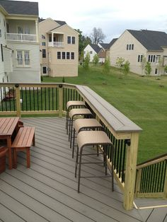 Not a difficult modification - turn your deck railing into a bar for plates and drinks