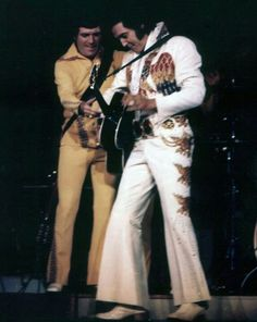 Charlie Hodge on stage with Elvis Presley in Concert: June 25, 1974 (8:30 pm) Columbus, OH