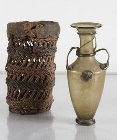 Roman glass amphora in protective basket, 4th-5th century A.D. Egypt, possibly Coptic, 16 cm high. Private collection