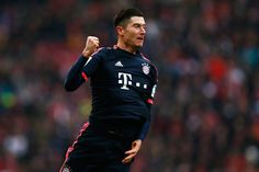 Robert Lewandowski of Bayern Muenchen celebrates scoring his teams first goal of the game during the Bundesliga match between 1. FC Koeln and FC Bayern Muenchen held at RheinEnergieStadion on March 19, 2016 in Cologne, Germany.