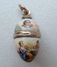 Tiny Enamel Vinaigrette Cherubs c1890, gilt wash egg charm.