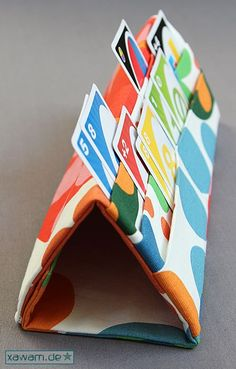 A playing card holder....great for little fingers or hands that need a hand with their poker hand.