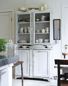 White wash antique cabinet stores lovely milky and pastel colored dishes