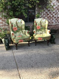 Wingback Arm Chair With A Wood Frame And Floral Print
