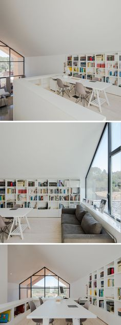 This loft area has been set up as a library / home office. A shelving unit runs along the wall and acts as a bookshelf and storage unit. A large white table provides space for four people to work at and underneath the window is a couch for relaxed reading. #ModernLibrary #HomeOffice #Shelving