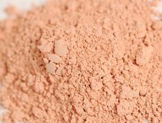 This is frisky a slight pink color to it not much but leaves a very naturally blushed look!