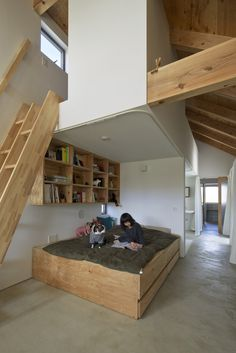 Above: The daughter's bedroom, which is sectioned off by a curtain, has a plywood platform bed with built-in drawers. A double ladder made of wood leads to the second bedroom, a sleeping loft.