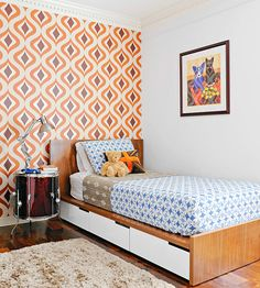 Bold graphic wallpaper in iconic brown and orange contrast the clean lines of modern furniture in this retro-chic children's bedroom design.